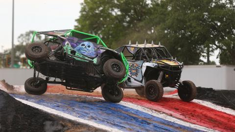 Grave Digger vs. Max-D - Photo by Brett Moist